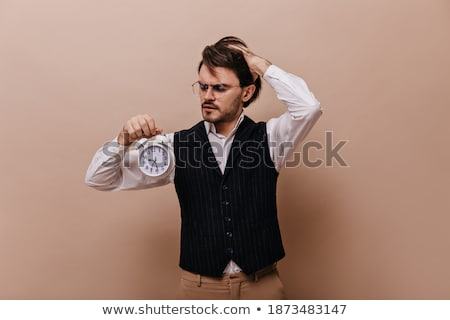 Anxious handsome man posing against a white background Stock photo © wavebreak_media