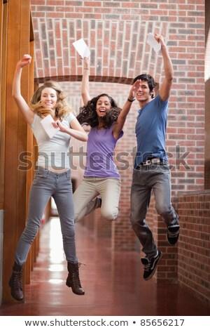 портрет · молодые · студентов · амфитеатр · счастливым - Сток-фото © wavebreak_media