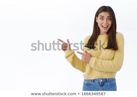 meglepődött · fiatal · nő · tart · valami · kéz · portré - stock fotó © kyolshin