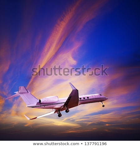 small private jet in sunset sky square composition stock photo © moses