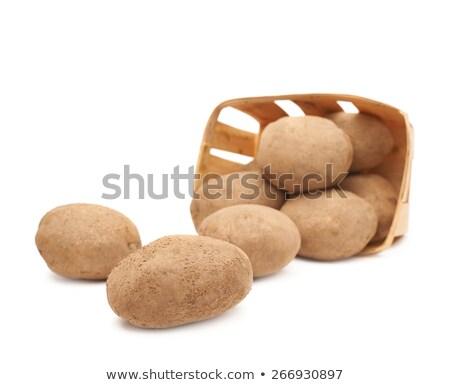 potato tuber in wicker basket isolated on white background stock photo © natika