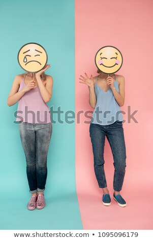 Smiles and one sad face Stock photo © alexmillos