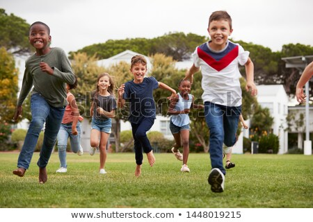 Boy And Girl Playing In Field Together Stock photo © monkey_business