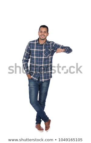 man leaning on a wall with his hand in pocket Stock photo © feedough