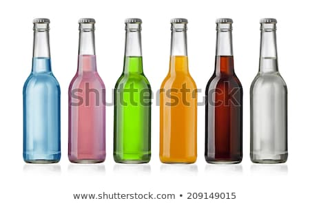 bottles fruit juice with drops of water isolated Stock photo © ozaiachin