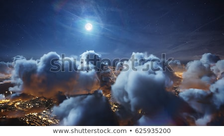 Moving clouds by the moon Stock photo © rmbarricarte