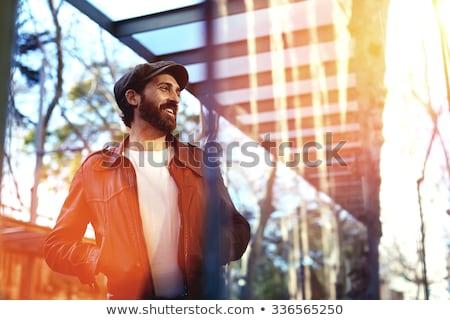 sorridente · maduro · casual · homem · jaqueta · de · couro - foto stock © feedough