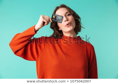 Smiling attractive young woman holding blank credit card Stock photo © deandrobot