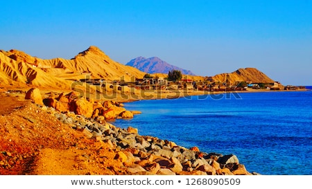 sun near a mountain in the ocean Stock photo © lkpro