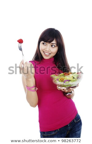 teenage girl eating broccoli stock photo © monkey_business