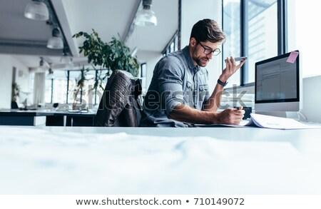 młody · człowiek · tabeli · biuro · pióro · strony · komputera - zdjęcia stock © traimak