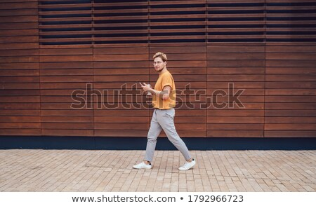 relaxed stylish man walks and looks down to side stock photo © feedough
