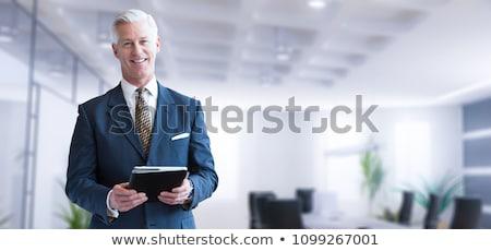 retrato · idoso · homem · trabalhando · secretária · sorridente - foto stock © minervastock