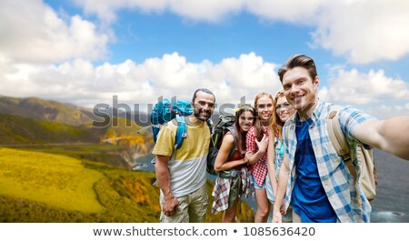 friends with backpack taking selfie over big sur Stock photo © dolgachov