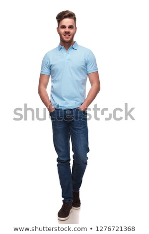 relaxed casual man wearing a polo shirt walking forward Stock photo © feedough