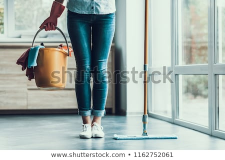 Young beautiful woman cleaning apartment  Stock photo © Elnur