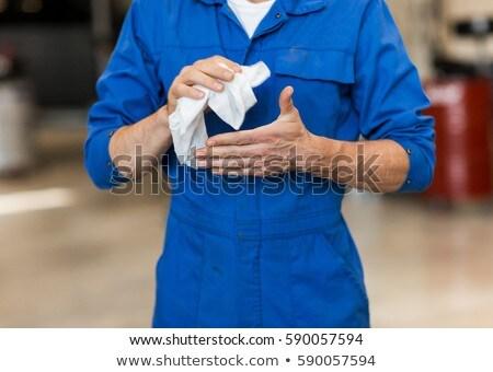 mechanic man or smith with wipe at car workshop Stock photo © dolgachov