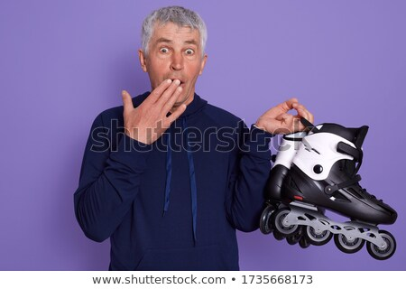 shocked man covering mouth by hands over blue sky Stock photo © dolgachov