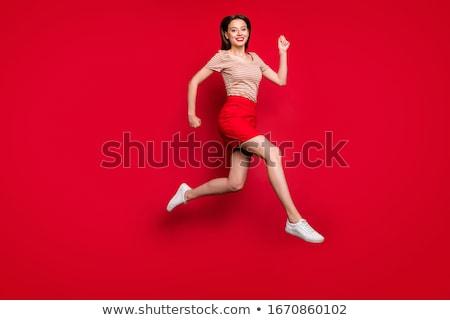 Heureux souriant fille rouge shirt jupe Photo stock © dolgachov