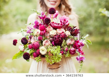 Woman in boho dress holding lush bouquet Stock photo © dashapetrenko