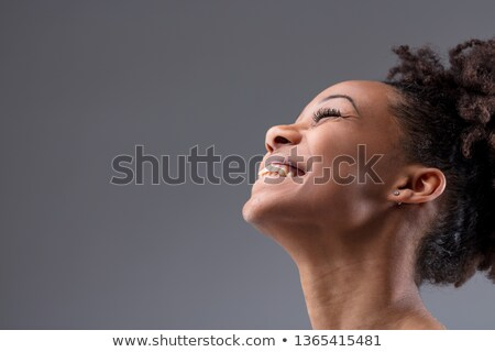 Close up shot of happy carefree African American woman laughs from joy, has healthy dark skin, curly Stock photo © vkstudio