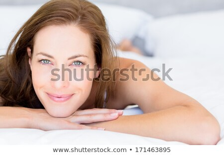 brunette with beautiful blue eyes lying Stock photo © photography33