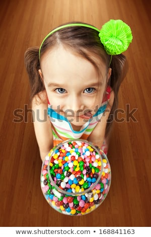 Girl with bowl of candy stock photo © photography33