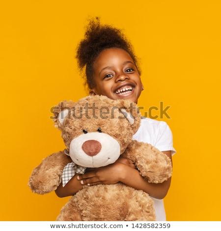Kicsi kislány játék plüssmaci játék születésnap Stock fotó © balasoiu