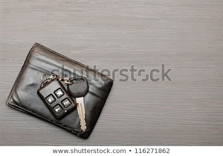 car keys and documents on dark wooden background Stock photo © inxti