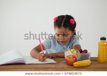 student holding an apple stock photo © luminastock