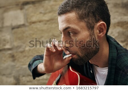dohányzás · cigaretta · kő · bőr · fiú · játszik - stock fotó © lunamarina
