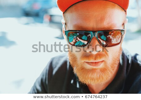 Sun glasses on forehead Stock photo © bigandt