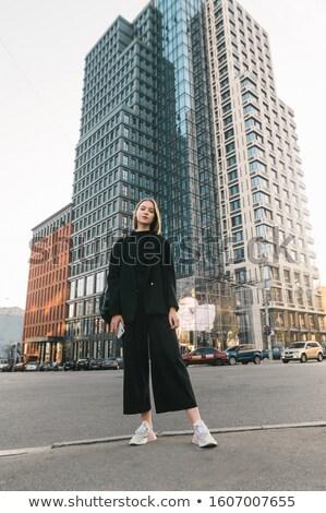 Woman Posing in Black Fashionable Corporate Attire Stock photo © dash