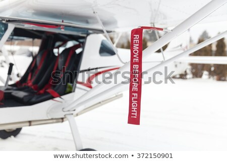 Airplane in Hangar with remove before flight Labels in red Stock photo © juniart