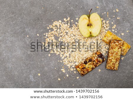 Muesli bar with apple, nuts and sugar Stock photo © michaklootwijk