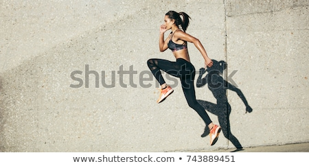 side view of young fitness woman stock photo © deandrobot