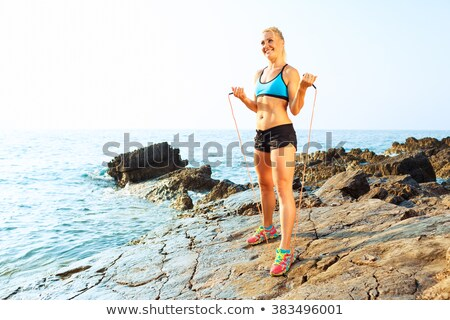 Sportowiec kobieta sportu skał morza Zdjęcia stock © vlad_star