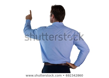 Rear view of businessman with hand on hip touching invisible interface Stock photo © wavebreak_media