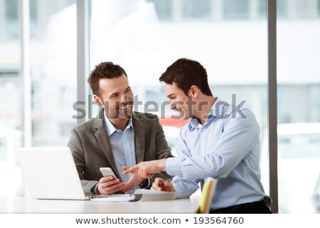 Two Businessmen looking on laptop Stock photo © IS2