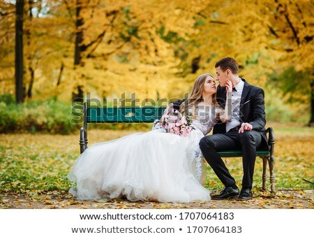 Couple sitting in a tree by a lake Stock photo © IS2