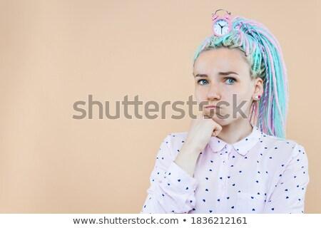 Young cute girl thinking and the clock Stock photo © konradbak