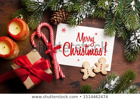 Christmas gift boxes, gingerbread cookies and fir tree Stock photo © karandaev
