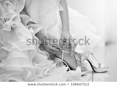 bride is putting on her shoes for the wedding day stock photo © ruslanshramko