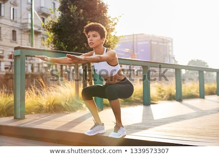 Fitness Activity in City Park, Woman Doing Squats Stock photo © robuart