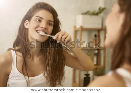 Brown-haired woman brushing teeth Stock photo © photography33