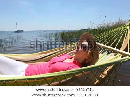 Mulher chapéu de palha relaxante verão lago rio Foto stock © photography33