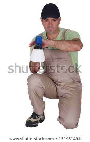 Man kneeling with paint sprayer Stock photo © photography33