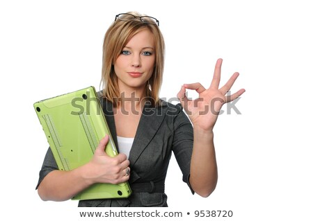Blonde businesswoman with a laptop giving the OK sign Stock photo © photography33