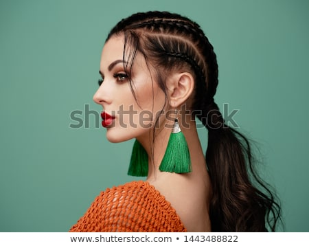 Luxury. Beautiful girl with earrings - stylish hairstyle Stock photo © gromovataya