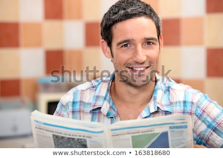 Man reading a journal in the kitchen Stock photo © photography33